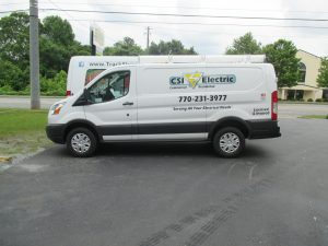 Cut vinyl vehicle graphics with digitally printed logo CSI Electric