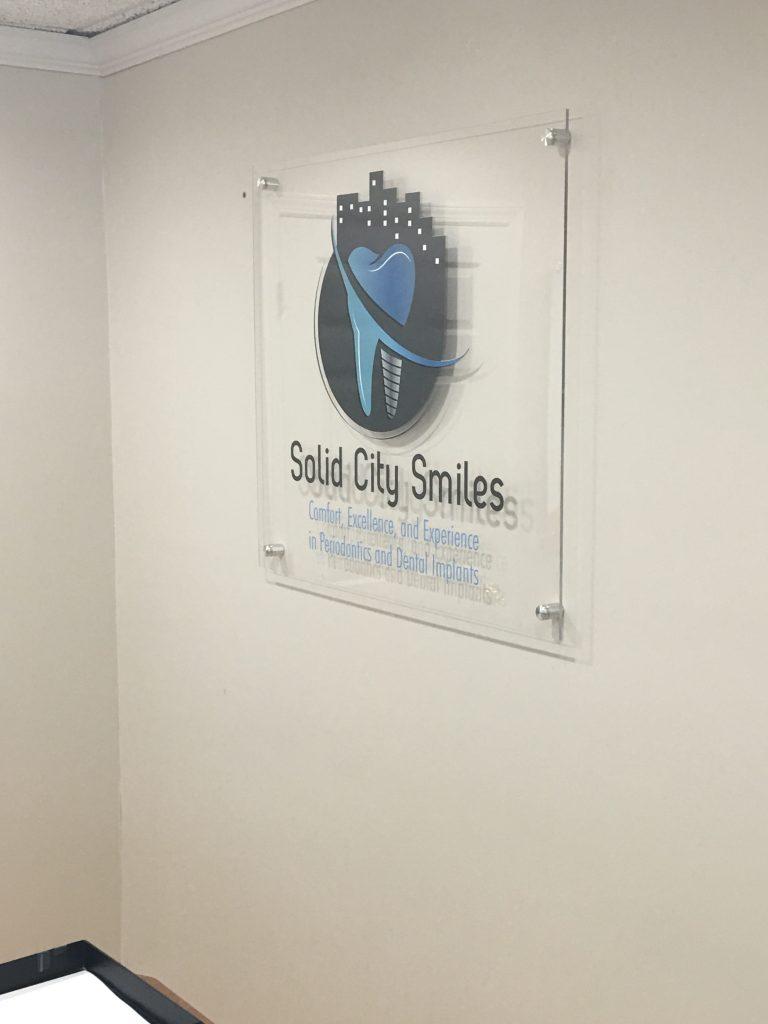 Digitally Printed logo on clear acrylic standoff