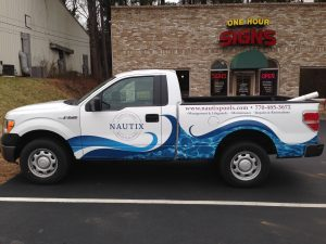 Partial truck wrap Nautix Pools
