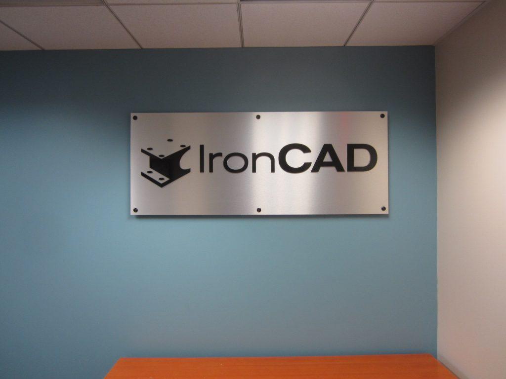 brushed polymetal standoff sign with raised acrylic logo