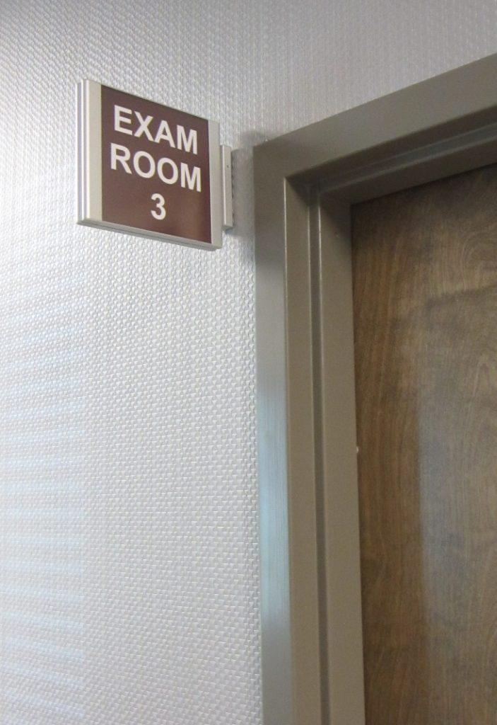 corridor sign bracket